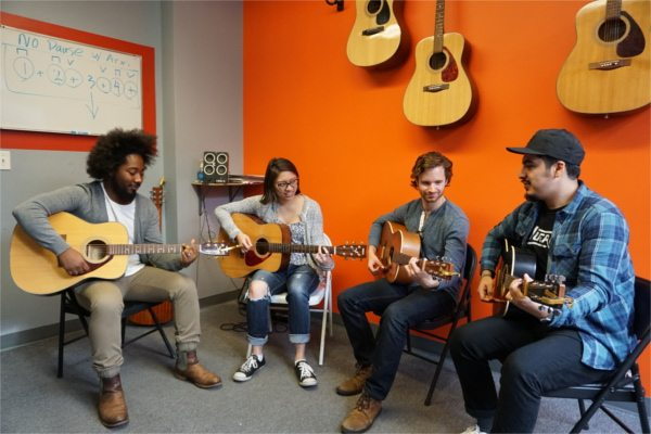 happy guitar students in Absolute Beginners class at NYC Guitar School