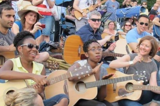 NYC Guitar School students singing and playing at Make Music Festival in Union Square NYC