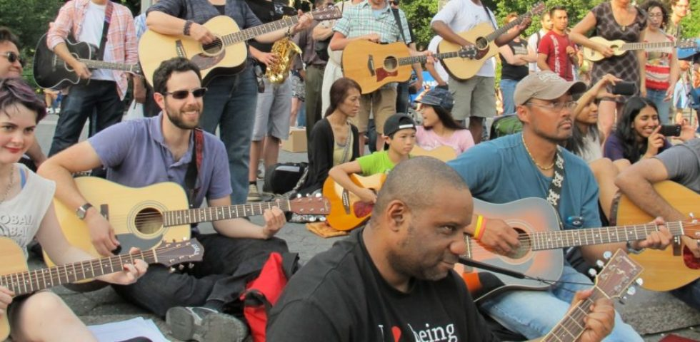 happy nyc guitar school students playing on the steps in Union Square Park with Make Music Festival