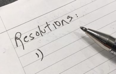 pen and paper with heading resolution and blank below